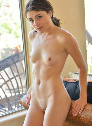 A young girl with a shaved pussy in a beach cabin 7